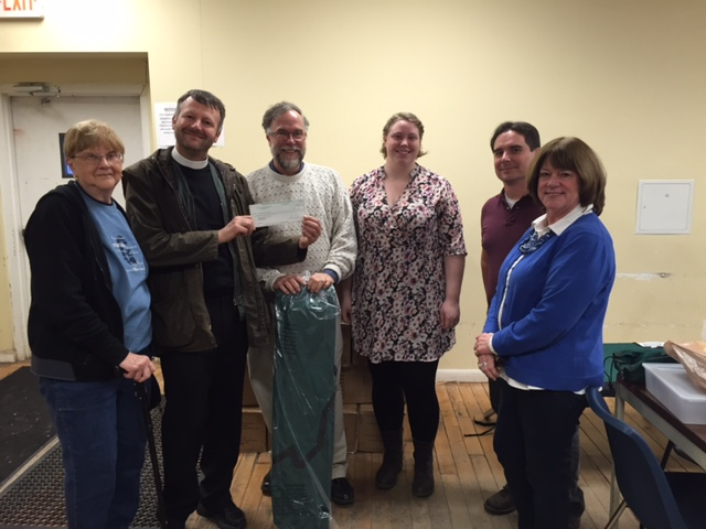 Church of the Good Shepherd, Acton, donating the funds to pay for Lowell Transitional Living Center Winter Emergency Bed Program cots in 2015.