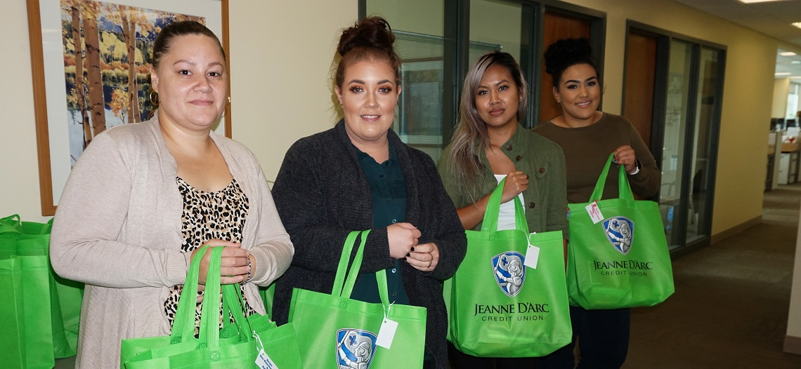 Jeanne D'Arc Credit Union Employees Offer 'A Sharing Hand' to Lowell Transitional Living Center